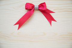 Red ribbon on a wood background with clipping paths. Red ribbon on a wood background with clipping paths Stock Images