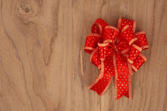 Red Ribbon on Wood for background for good news Stock Photos