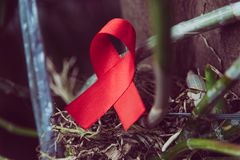 Red ribbon for world aids day awareness campaign background. Red ribbon for world aids day awareness campaign stock photos