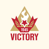 Red ribbon with a year of victory 1945, a star with a torch. Stock Image