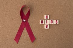 Red ribbons aids ribbon with AIDS/HIV word on notice board. Aids / HIV Concept. healthcare and medical concept stock images