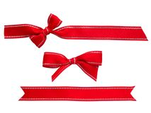 Red ribbons and bows. Isolated on white Stock Photos