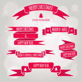 Red ribbons with greeting. Red ribbons and bands for New Year's and Christmas greetings Royalty Free Stock Photography