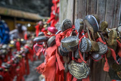 Red ribbons and lock stock image