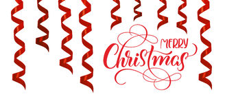 Red ribbons streamer as decoration with text Merry Christmas. Lettering calligraphy Stock Photos