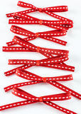 Red ribbons tied in bows Royalty Free Stock Image