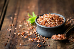 Red rice in a bowl Stock Photos