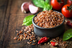 Red rice in a bowl Stock Images