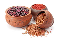 Red rice and lentils in clay pots Stock Image