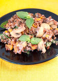 Red rice with mushrooms, carrot and basil Royalty Free Stock Photography