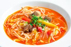 Red rice noodle soup Stock Images