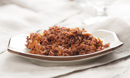 Red rice with onion and carrot Stock Image