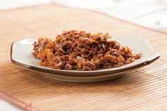 Red rice with onion and carrot Stock Photography