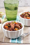 Red rice pilaf with chicken Stock Photos