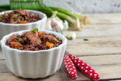 Red rice pilaf with chicken Royalty Free Stock Images