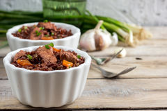 Red rice pilaf with chicken Royalty Free Stock Image