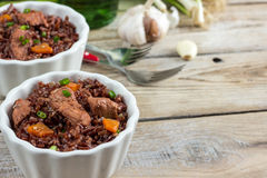 Red rice pilaf with chicken. Healthy food concept: red rice pilaf with chicken. Selective focus Stock Photo