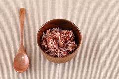 Red rice in a small ceramic dish Stock Photo