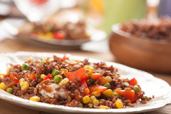 Red rice with vegetables Stock Image