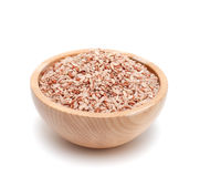 Red rice in a wooden bowl Stock Image