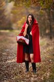 Red Riding Hood cosplay in the forest royalty free stock photography