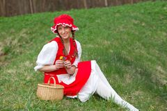 Red Riding Hood in the meadow Stock Image