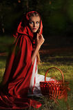Red riding hood. Sits in a clearing in the forest Stock Photo