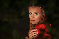 Red riding hood. Sits in a clearing in the forest Royalty Free Stock Photos