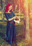 Red Riding  hood standing in a wood Royalty Free Stock Images