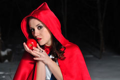 Red Riding Hood in the winter forest Stock Photo