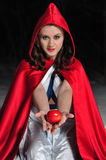Red Riding Hood in the winter forest Stock Photos