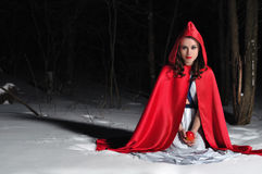 Red Riding Hood in the winter night forest Royalty Free Stock Photography