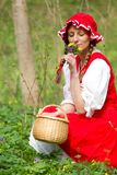 Red Riding Hood in the wood Royalty Free Stock Image