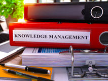 Red Ring Binder with Inscription Knowledge Management. 3D. Royalty Free Stock Photos