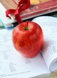 Red ripe apple with English textbooks Royalty Free Stock Photos