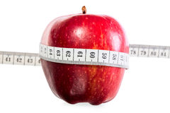 Red ripe apple with a measuring tape Stock Images