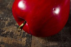 Red ripe apple. On an old wooden table Stock Photos