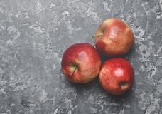 Red ripe apples on a concrete table. Fresh fruits. stock images