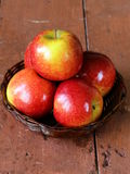 Red ripe apples in a wicker basket Royalty Free Stock Images