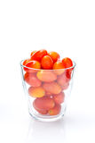 Red ripe berry tomato in glass white background. Berry tomato in glass white background Royalty Free Stock Photography