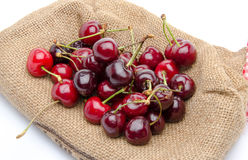 Red ripe cherries on burlap Stock Image