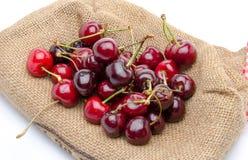 Red ripe cherries on burlap Stock Image