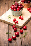 Red ripe cherries in ceramic bowls Royalty Free Stock Image