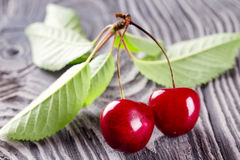 Red ripe cherries with leaves stock photos