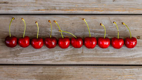 Red ripe cherries on wooden background Stock Photo