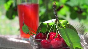 Red ripe cherry cherry juice on natural stock video footage