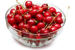 Red-ripe cherry in glass bowl Stock Photos