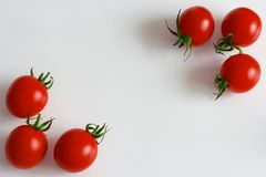 Red ripe cherry tomatoes on a white background royalty free stock photography