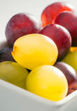 Red ripe grapes and green Royalty Free Stock Image