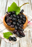 Red ripe grapes in a wooden bowl Royalty Free Stock Image